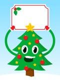 Glücklicher Weihnachtsbaum mit einer festlichen leeren Fahne Stockbild