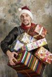 Glücklicher Weihnachtsmann mit Geschenken Lizenzfreies Stockbild