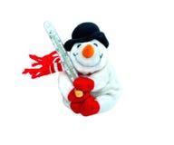 Glücklicher Winterspielzeug-Weihnachtsschneemann mit Karotte im schwarzen Hut und in den roten Handschuhen Lizenzfreies Stockfoto
