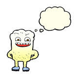 glücklicher Zahn der Karikatur mit Gedankenblase Stockfotos