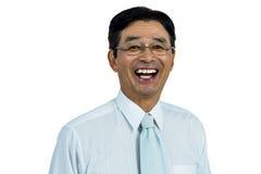 Glückliches asiatisches Geschäftsmannlächeln Stockfotos