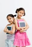 Glückliches asiatisches Kind mit Tablet-Computer Lizenzfreies Stockbild