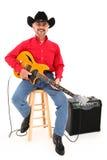 Glückliches attraktives Land-Musiker-Alter 75 Stockfoto