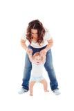 Glückliches Baby, das erste Jobstepps tut stockfotografie