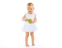 Glückliches Baby und Apfel Stockfotos