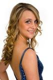 Glückliches blondes Schauen über Schulter Lizenzfreie Stockbilder