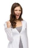 Glückliches Damenfaustgestikulieren Stockfoto