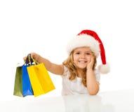Glückliches Einkaufen des kleinen Mädchens Weihnachts Lizenzfreie Stockfotos