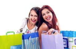 Glückliches Einkaufenmädchen Stockfotos
