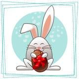 Glückliches Esterkaninchen und mehrfarbige Eier Stockfotografie