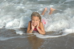 Glückliches Ferien-Kind Stockfoto