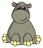 Glückliches Flusspferd sitzt Stockfoto
