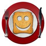 Glückliches Frühstücks-Konzept - lächelnder Zwieback Lizenzfreie Stockfotos