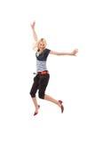 Glückliches Frauenspringen Stockbild