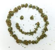 Glückliches Gesicht gemacht vom Marihuana Stockfotografie