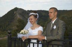Glückliches Hochzeitslächeln Stockfoto