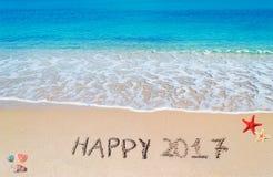 Glückliches 2017 im Sand Stockbilder
