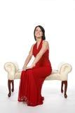 Glückliches jugendlich im roten Kleid Stockfotografie