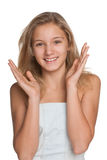Glückliches jugendliches Mädchen gegen das Weiß Lizenzfreie Stockfotografie