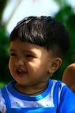 Glückliches junges asiatisches Kind Stockbild