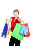 Glückliches Fraueneinkaufen für Kleidung Lizenzfreies Stockfoto