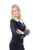 Glückliches junges blondes Geschäftsfraulächeln Stockbild