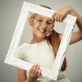 Glückliches junges Mädchen Stockfoto
