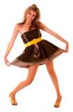 Glückliches junges Mädchen im lustigen Kleid Lizenzfreie Stockbilder