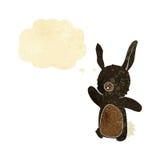 glückliches Kaninchen der Karikatur mit Gedankenblase Lizenzfreies Stockfoto