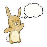 glückliches Kaninchen der Karikatur mit Gedankenblase Stockfoto