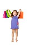 Glückliches Kind, das Geschenke und Feiertage genießt Lizenzfreie Stockbilder