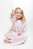 Glückliches Kind in ihren Pyjamas Lizenzfreie Stockfotografie