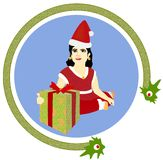 Glückliches Kind im roten Kostüm mit Weihnachtsgeschenk Stockfotos