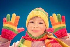 Glückliches Kind im Winter Stockfotos