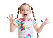 Glückliches Kindermädchen mit den gemalten Händen Lizenzfreies Stockbild
