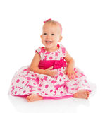 Glückliches kleines Baby im hellen rosa festlichen Kleid lokalisiert Stockbilder