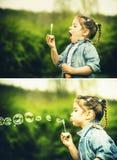 Glückliches kleines hübsches Mädchen im Freien in den Schlagblasen des Parks Stockfoto