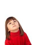 Glückliches kleines Mädchen, das oben schaut Lizenzfreies Stockbild