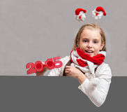 Glückliches kleines Weihnachtskindermädchen Stockfotografie