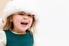 Glückliches Kleinkindmädchen mit einem Sankt-Hut Lizenzfreie Stockfotos