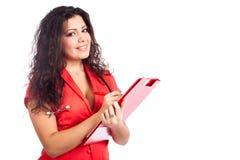 Glückliches Krankenschwester- oder Frauendoktorschreiben auf Klemmbrett Lizenzfreies Stockbild