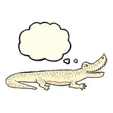 glückliches Krokodil der Karikatur mit Gedankenblase Stockbilder