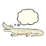 glückliches Krokodil der Karikatur mit Gedankenblase Stockfoto