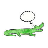 glückliches Krokodil der Karikatur mit Gedankenblase Lizenzfreie Stockfotos