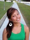 Glückliches Lächeln auf asiatischer Dame stockfoto
