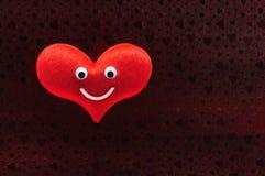 Glückliches Lächeln des roten Herzgesichtes Stockbild