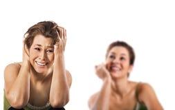 Glückliches Lächeln und eine unglückliche deprimierte Frau Lizenzfreies Stockfoto