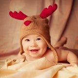 Glückliches lächelndes Baby stockfoto