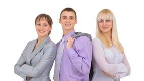 Glückliches lächelndes erfolgreiches Geschäftsteam im Büro Stockfoto