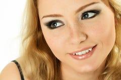 Glückliches lächelndes Frauengesicht Stockfotografie